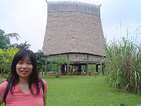 A full-size replica of a 'rong' house in the gardens of the ethnology museum