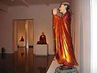An exhibit in a gallery designed to house Buddhist effigies