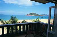 All rooms have balcony views of the beach, the bay, and the islands