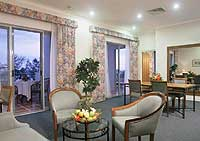 Suites are larger and have good views across the gardens to the beach