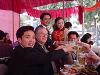 There are many guests at the wedding banquet - often  in the hundreds. It's a jolly occasion with plenty to eat and drink