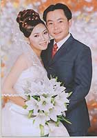 This isang and her husband. In Vietnam, wedding photographs are taken in advance, usually in a studio - the bride wears heavy make-up and a complicated hairstyle