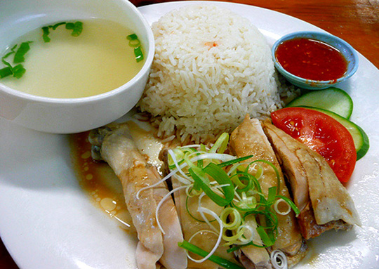 singapore chicken rice has its roots in hainan island china but it is ...
